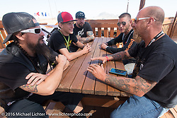 Pat Patterson, Bill Dodge, Josh Owens and Will Ramsey with student bike builder Logan Lucas at the Builder Breakfast for people to meet with the participants of Michael Lichter's Motorcycles as Art Exhibition at the Buffalo Chip Crossroads during the annual Sturgis Black Hills Motorcycle Rally.  SD, USA.  August 7, 2016.  Photography ©2016 Michael Lichter.