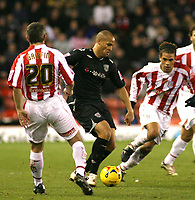Photo:Mark Stephenson, Stoke City v West Bromwich Albion.<br />Coca Cola Championshipe,25-11-2006.<br />West Broms Nigel Quashie with the ball and Stokes Andy Griffin