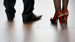 Embargoed to 0001 Tuesday August 1 File photo dated 15/09/09 of a male and female worker. Researchers have called for action to stop women being forced to wear high heels at work.