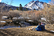 A Couple with Their Dog Sitting and Resting in the Eastern Sierra's