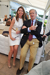 JOCK GREEN-ARMYTAGE Chairman of Guards Polo Club and MELISSA STISTED at the Audi International Polo Day held at Guards Polo Club, Smith's Lawn, Windsor on 22nd July 2012.