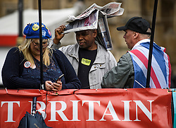 © Licensed to London News Pictures. 21/10/2019. London, UK. Anti-Brexit protestors gather outside the Houses of Parliament in Westminster, London in heavy rain. Last week Parliament sat on a Saturday for the first time since 1982, but failed to vote on Boris Johnson's new Brexit deal. Photo credit: Ben Cawthra/LNP