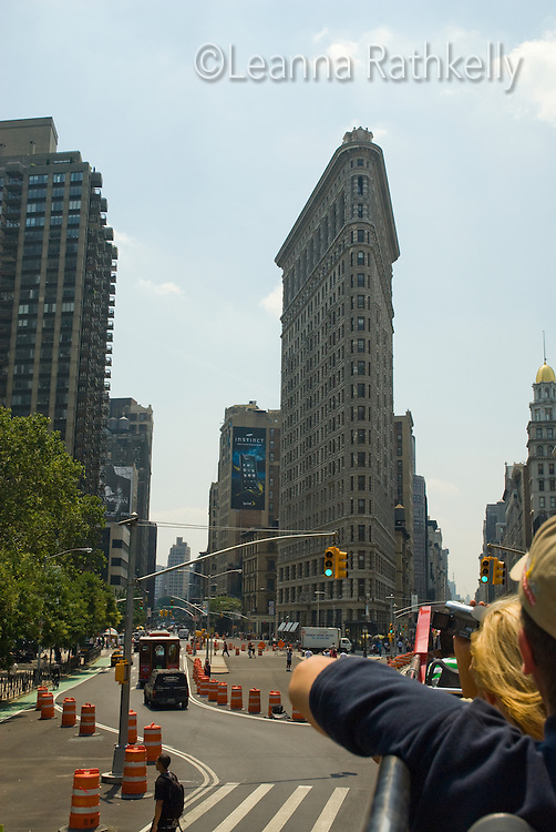 The Flatiron Building, which when constructed was called the Fuller Building, was one of the tallest buildings in New York City upon its completion in 1902 and is considered one of the first skyscrapers. The building, at 175 Fifth Avenue in the borough of Manhattan, sits on a triangular island block at 23rd Street, Fifth Avenue, and Broadway, anchoring the south (downtown) end of Madison Square.