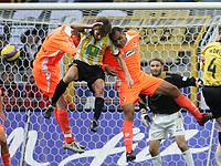 Fotball<br /> Bundesliga<br /> 04.03.2007<br /> Foto: Witters/Digitalsport<br /> NORWAY ONLY<br /> <br /> v.l. Kevin McKenna, Ebi Smolarek, Vragel da Silva Cottbus<br /> Bundesliga Borussia Dortmund - FC Energie Cottbus