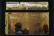 Commuters travel by bus on Third Avenue during a stormy evening in downtown Seattle. (Erika Schultz / The Seattle Times)