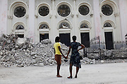 Girls look at the Notre Dame Cathedral, destroys due to Jan.12 earthquake in downtown Port-au-Prince, Haiti, Jan. 31,  2010. (AP Photo/Rodrigo Abd)