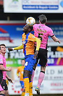 Northampton Town defender David Buchanan Northampton Town defender Zander Diamond battle in the air during the Sky Bet League 2 match between Mansfield Town and Northampton Town at the One Call Stadium, Mansfield, England on 28 March 2016. Photo by Jon Hobley.