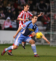 Photo: Pete Lorence.<br />Lincoln City v Wycombe Wanderers. Coca Cola League 2. 30/12/2006.<br />Matt Bloomfield shields the ball from Ryan Amoo.