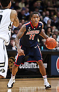 SHOT 1/21/12 6:48:59 PM - Arizona's Josiah Turner #11 looks to pass while playing against Colorado during their PAC 12 regular season men's basketball game at the Coors Events Center in Boulder, Co. Colorado won the game 64-63..(Photo by Marc Piscotty / © 2012)