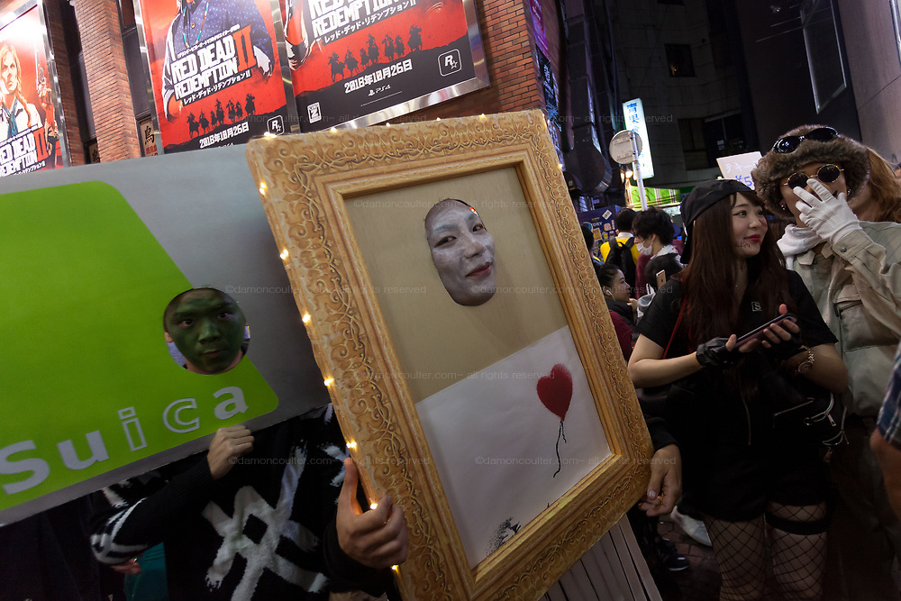 A Japanese man dressed as the shredding artwork by Banksey during the Halloween celebrations Shibuya, Tokyo, Japan. Saturday October 27th 2018. The celebrations marking this event have grown in popularity in Japan recently. Enjoyed mostly by young adults who like to dress up, drink , dance and misbehave in parts of Tokyo like Shibuya and Roppongi. There has been a push back from Japanese society and the police to try to limit the bad behaviour.
