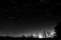 Winter Nighttime Sky Over New Jersey. Composite star trail image 02:30-02:59) taken with a Nikon D810a camera and 19 mm f/4 PC-E lens (ISO 400, 19 mm, f/8, 120 sec). Raw images processed with Capture One Pro and the composite created with Photoshop CC (statistics, maximum). Conversion to B&W with Capture One Pro.