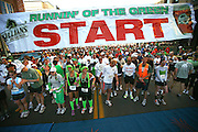 SHOT 3/15/09 10:00:38 AM - Some of the 5,500 participants line up at the starting line at the Running of the Green Lucky 7K race in Downtown Denver, Co. Proceeds from the race benefit Volunteers of America. Billed as the nation's largest 7K, the run/walk follows an urban course through the streets of LoDo, along side the Platte Valley and concludes at McCormick's Fish House and Bar. Following the race will be an unforgettable block party, including live music and traditional Irish food. The race is held in conjunction with the celebration of St. Patrick's Day. Saint Patrick's Day (Irish: Lá 'le Pádraig or Lá Fhéile Pádraig), colloquially St. Paddy's Day or Paddy's Day, is an annual feast day which celebrates Saint Patrick (circa AD 385-461), one of the patron saints of Ireland, and is generally celebrated on March 17..The day is the national holiday of Ireland. It is a bank holiday in Northern Ireland and a public holiday in the Republic of Ireland and Montserrat. In Canada, Great Britain, Australia, the United States and New Zealand, it is widely celebrated but is not an official holiday..(Photo by Marc Piscotty / © 2009)