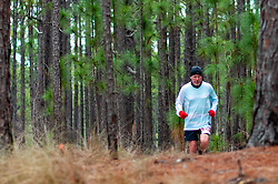 January 19, 2019 - Southern Pines, North Carolina, US - Jan. 19, 2019 - Southern Pines N.C., USA - Jon Hunter, Durham, North Carolina, completes a lap during the 10th Annual Weymouth Woods 100km ultra marathon at the Weymouth Woods Nature Preserve. Runners needed to complete 14 laps of the 4.47 mile course for 62.58 miles in under the 20-hour time allotment. (Credit Image: © Timothy L. Hale/ZUMA Wire)