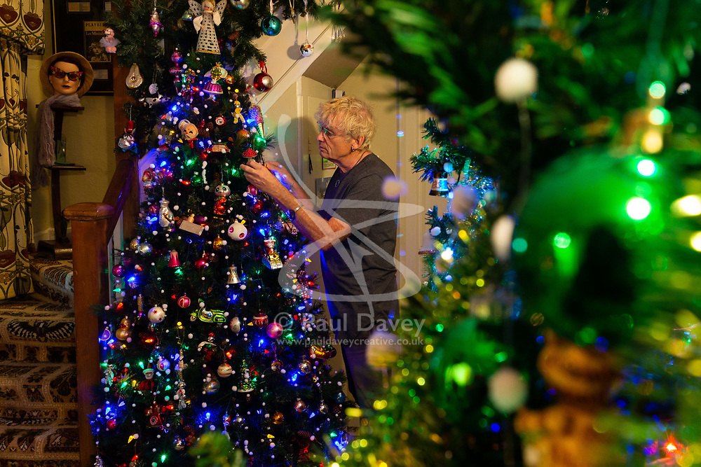 Geoff Stonebanks, 66, decorates one of several trees in the hallway of his home in Seaford, East Sussex, where he uses over 3,800 decorations on more than a dozen trees, creating a magical effect that truly celebrates the festive season. Seaford, East Sussex, December 03 2018.