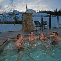 Friends enjoy a hot tub at the Mountain Village at Big Sky Resort, Big Sky, Montana
