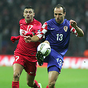 Turkey's Burak YILMAZ (L) and Croatia's Gordon SCHILDENFELD (R) during their UEFA EURO 2012 Play-off for Final Tournament First leg soccer match Turkey betwen Croatia at TT Arena in Istanbul Nüovember11, 2011. Photo by TURKPIX