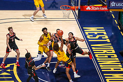 Jan 25, 2021; Morgantown, West Virginia, USA; West Virginia Mountaineers guard Miles McBride (4) shoots the go ahead basket late in the second half against the Texas Tech Red Raiders at WVU Coliseum. Mandatory Credit: Ben Queen-USA TODAY Sports