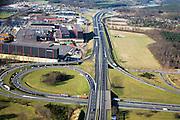 Nederland, Noord-Brabant, Bergen op Zoom, 04-03-2008; knooppunt Zoomland met de nieuwe A4 in Noordelijke richting (onder in beeld de reeds bestaande A 58 richting); in de oksel van het verkeersplein op het bedrijventerrein De Lage Meren de sigarettenfabriek van Philip Morris; tabak, nicotine, sigaret, sigaretten. .luchtfoto (toeslag); aerial photo (additional fee required); .foto Siebe Swart / photo Siebe Swart