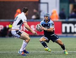 Matthew Morgan of Cardiff Blues under pressure from Mark Bennett of Edinburgh Rugby<br /> <br /> Photographer Simon King/Replay Images<br /> <br /> Guinness PRO14 Round 2 - Cardiff Blues v Edinburgh - Saturday 5th October 2019 -Cardiff Arms Park - Cardiff<br /> <br /> World Copyright © Replay Images . All rights reserved. info@replayimages.co.uk - http://replayimages.co.uk