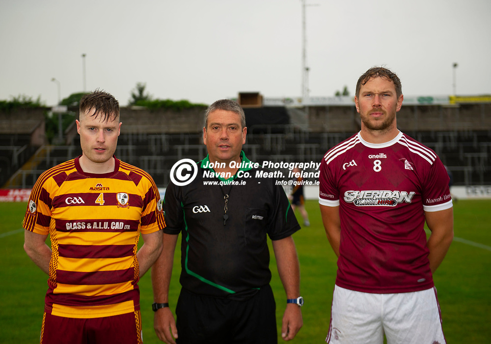27-07-21. Carnaross v St. Vincent's Tailteann Cup Final 2020.<br /> Carnaross captain Ian Donoghue and St. Vincent's captain Robert Tallon pictured with referee Joey Curley.<br /> Photo: John Quirke / www.quirke.ie<br /> ©John Quirke Photography, 16 Proudstown Road, Navan. Co. Meath. (info@quirke.ie / 046-9028461 / 087-2579454).
