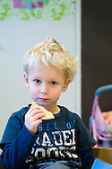 Nederland, Veghel, 20101117.?Jongen op de creche. Hij eet zijn boterham. Hij kijkt in de camera. ?Kinderopvang 't Kroontje in Veghel...Netherlands, Veghel, 20101117. ?Boy at the nursery. He eats his sandwich. He looks into the camera.?Childcare t Kroontje in Veghel..