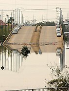 A street is flooded in New Orleans August 30, 2005. The historic city of New Orleans was steadily filling with water from nearby Lake Ponchartrain on Tuesday after its defenses were breached by the ferocity of hurricane Katrina.  With the floodwaters rising in many areas, threatening the French Quarter, residents were plucked from the roofs of their homes, bodies were seen floating in the streets and rescuers searched the city in boats and helicopters. REUTERS/Rick Wilking