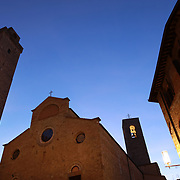 SAN GIMIGNANO, ITALY - OCTOBER 25: The Piazza della Cisterna in San Gimignano, Italy. San Gimignano is an Italian hill town in Tuscany, southwest of Florence. Encircled by 13th-century walls, its old town centers on Piazza della Cisterna, a triangular square lined with medieval houses. It has a skyline of medieval towers, including the stone Torre Grossa. San Gimignano, Tuscany, Italy. 25th October 2017. Photo by Tim Clayton/Corbis via Getty Images)