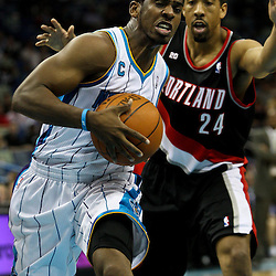March 30, 2011; New Orleans, LA, USA; New Orleans Hornets point guard Chris Paul (3) drives past Portland Trail Blazers point guard Andre Miller (24) during the first half at the New Orleans Arena.    Mandatory Credit: Derick E. Hingle