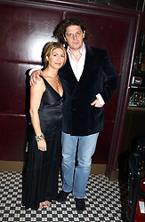 Chef MARCO PIERRE WHITE and his wife MATI at a fund raising dinner hosted by Marco Pierre White and Frankie Dettori's in aid of Conservative Party's General Election Campaign Fund held at Frankie's No.3 Yeoman's Row,æLondon SW3 on 17th January 2005.<br />