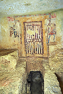 """Underground Etruscan tomb """"Tomba dei Caronti"""" made about 150-125 BC. This tomb has a higher level with 2 painted false doors that was furnished with seats as was probably used for religious functions, steps lead down to a lower burial chamber. Excavated 1960 , Etruscan Necropolis of Monterozzi, Monte del Calvario, Tarquinia, Italy. A UNESCO World Heritage Site. .<br /> <br /> Visit our ETRUSCAN PHOTO COLLECTIONS for more photos to buy as buy as wall art prints https://funkystock.photoshelter.com/gallery-collection/Pictures-Images-of-Etruscan-Historic-Sites-Art-Artefacts-Antiquities/C0000GgxRXWVMLyc"""