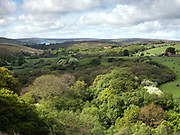Spring landscape near Castleton village in the North York Moors National Park on 17 May 2018. The North York Moors consist of a moorland plateau, intersected by a number of deep dales or valleys containing cultivated land or woodland