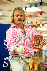 """Leigh Francis in character as TV JUICE host Keith Lemon poses for for the press at WHSmith Meadowhall shopping centre in Sheffield. during his book tour for 'Keith Lemon: The Rules""""  The event scheduled for 5:00 - 5:30 was so popular that Keith started signing early and didn't finish until 7:05pm as well as sales of the book being restricted.  .1st November 2011. Image © Paul David Drabble"""
