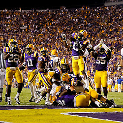 October 16, 2010; Baton Rouge, LA, USA; The LSU Tigers defense celebrates following a safety against the McNeese State Cowboys during the first half at Tiger Stadium.  Mandatory Credit: Derick E. Hingle