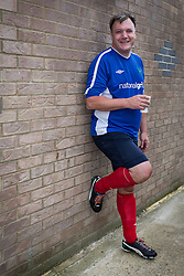 © Licensed to London News Pictures . 22/09/2013 . Lancing , UK . Shadow Chancellor Ed Balls ' poses wearing his rainbow laces worn in support of an anti homophobia in football campaign , following the matching . Labour Party vs journalists football match . Day 1 of the Labour Party 's annual conference in Brighton . Photo credit : Joel Goodman/LNP