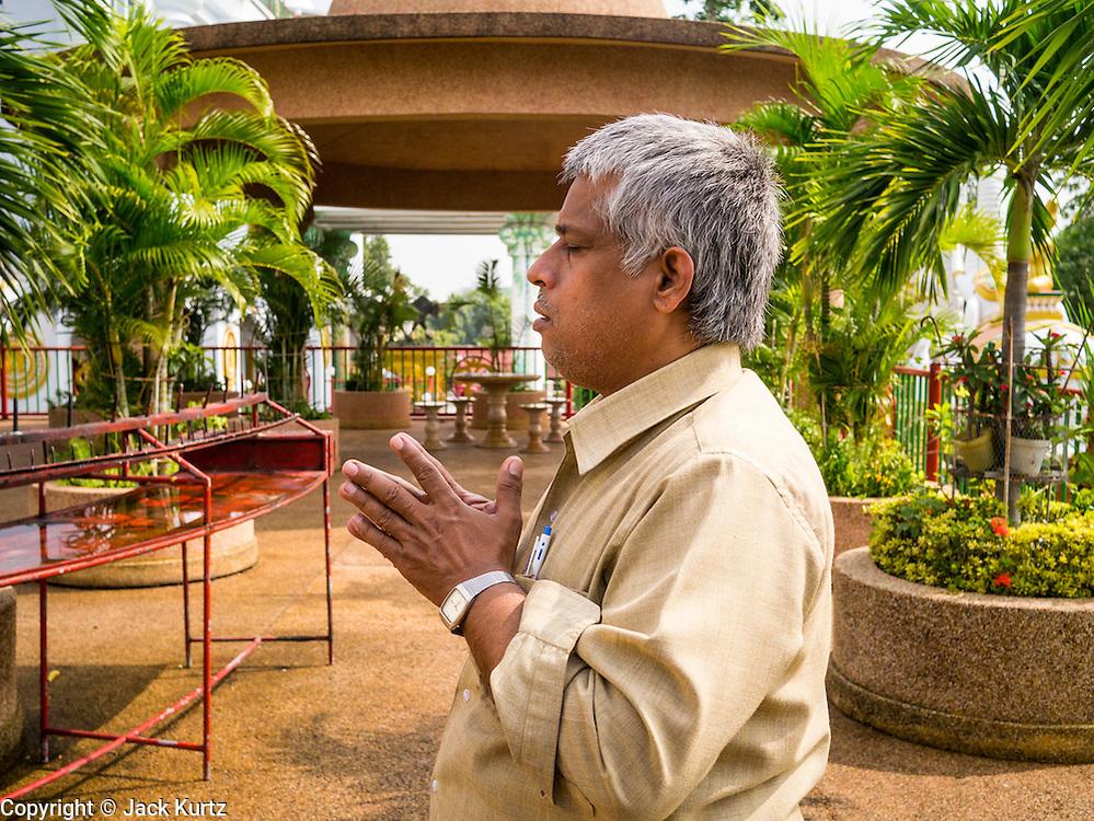 30 SEPTEMBER 2012 - BANGKOK, THAILAND: An Indian man prays at the Shiva Temple in the Raminthra neighborhood of Bangkok, Thailand. The temple is popular with Bangkok's Indian community.      PHOTO BY JACK KURTZ