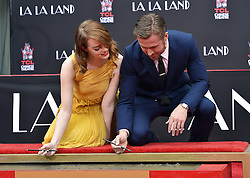 Ryan Gosling and Emma Stone's Hand and Footprint Ceremony outside the TCL Chinese Theatre in Los Angeles, California. 07 Dec 2016 Pictured: Emma Stone and Ryan Gosling. Photo credit: Bauer Griffin / MEGA TheMegaAgency.com +1 888 505 6342