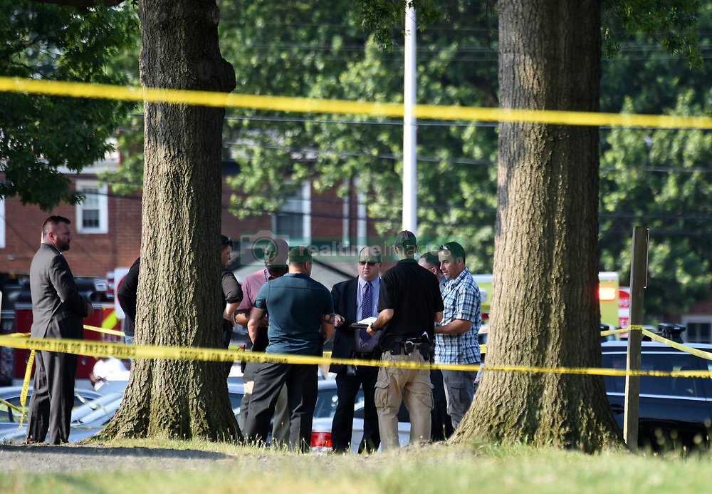 June 14, 2017 - Alexandria, Virginia, U.S. - Police officers work at the site of the shooting at Eugene Simpson Stadium Park. The gunman who opened fire Wednesday morning at a U.S. congressional baseball practice field has been identified as James T. Hodgkinson, a white male in his 60s. (Credit Image: © Yin Bogu/Xinhua via ZUMA Wire)