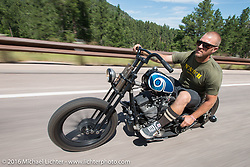 Taber Nash of Nash Custom Cycles on his hand shift evo on the Cycle Source/Lichter Ride during the annual Sturgis Black Hills Motorcycle Rally.  SD, USA.  August 10, 2016.  Photography ©2016 Michael Lichter.