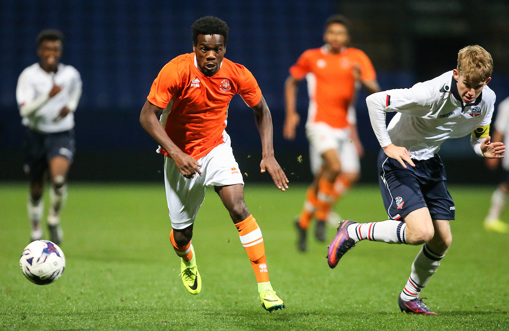 Blackpool's Ralph Chea gets away from Bolton Wanderers' Harry Brockbank<br /> <br /> Photographer Alex Dodd/CameraSport<br /> <br /> FA Youth Cup First Round - Bolton Wanderers v Blackpool - Wednesday 2nd November 2016 - Macron Stadium - Bolton<br />  <br /> World Copyright © 2016 CameraSport. All rights reserved. 43 Linden Ave. Countesthorpe. Leicester. England. LE8 5PG - Tel: +44 (0) 116 277 4147 - admin@camerasport.com - www.camerasport.com