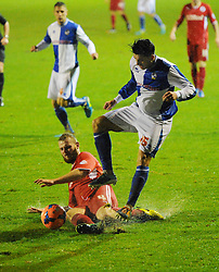 Bristol Rovers' Oliver Norburn is tackles by Crawley Town's Mark Connolly - Photo mandatory by-line: Seb Daly/JMP - Tel: Mobile: 07966 386802 18/12/2013 - SPORT - FOOTBALL - Broadfield Stadium - Crawley - Crawley Town v Bristol Rovers - FA Cup - Replay