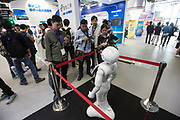 Visitors take pictures of a robot while attending the 2015 Computing Conference in Hangzhou, China, on Wednesday, Oct. 14, 2015. Alibaba Group Holding Ltd.s bet on data technology is driving greater investment in areas including ways to protect user privacy as it battles Amazon.com Inc. for customers globally.
