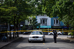 Police are shown at the perimeter of the scene of a shooting in east Toronto, on Monday, July 23, 2018. Police were trying Monday to determine what prompted a 29-year-old man to go on a shooting rampage in a popular Toronto neighbourhood, killing two people and injuring 12 others.THE CANADIAN PRESS/Christopher Katsarov