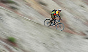 """Tim Skafidas of Steamboat Springs, Co. screams down a steep incline on """"Zippety Do Da"""" in the Bookcliffs trail system at the 11th Annual Fruita Fat Tire Festival on Sunday April 30, 2006. The Festival went back to its roots this year featuring loosely organized rides many hosted by local riders, expo tents, music and plenty of riding on the many trails that have made Fruita famous world-wide. The event lasted all weekend..(MARC PISCOTTY/ © 2006)"""