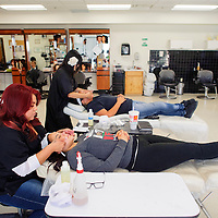 100614  Adron Gardner/Independent<br /> <br /> Cosmetology students Tristen Paquin, left, and Tori Tarango perform facials for Tesa Frejo and Katie Honawa during the Relay for Life Spa Day at the University of New Mexico in Gallup Monday.