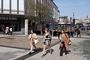 As the third national coronavirus lockdown continues, more people begin to come to the city centre shopping district as the country enjoys the first days of the easing of lockdown restrictions on 30th March 2021 in Birmingham, United Kingdom. After months of lockdown, the first signs that life will start to get back to normal begin, with more people enjoying the company of others in public, as the rule of six starts the first stage of lockdown ending.