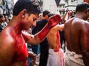 24 OCTOBER 2015 - YANGON, MYANMAR: Shia men and teenagers participate in ritual self flagellation with razors and chains during Ashura observances at Mogul Mosque in Yangon. Ashura commemorates the death of Hussein ibn Ali, the grandson of the Prophet Muhammed, in the 7th century. Hussein ibn Ali is considered by Shia Muslims to be the third imam and the rightful successor of Muhammed. He was killed at the Battle of Karbala in 610 CE on the 10th day of Muharram, the first month of the Islamic calendar. According to Myanmar government statistics, only about 4% of the population is Muslim. Many Muslims have fled Myanmar in recent years because of violence directed against Burmese Muslims by Buddhist nationalists.     PHOTO BY JACK KURTZ