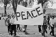 """09 May 1970, Washington, DC, USA --- Anti-Vietnam War protesters in Washington DC hold a sign that reads """"Peace"""" during a demonstration for the students killed at Kent State. --- Image by © Leif Skoogfors"""