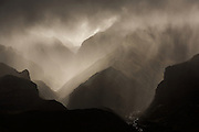 Monsoon rains pour over the lower hills of the Ghami Himal in the upper Mustang Region of Nepal. (Photo by David Stubbs)
