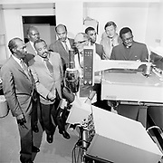 """Y-710529-08. """"Emanuel Hospital. Albina ministers and Chaplain Addix with medical equipment. May 29, 1971. (note says #4 enlarged 8/31/1995 and given to Adddix at retirement)."""