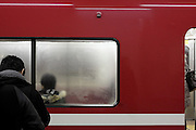 commuter train Tokyo with fogged up window
